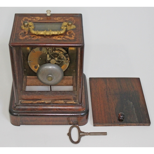 3 - A French late 19th century marquetry inlaid rosewood mantel clock, gilt metal handle and bevelled gl...