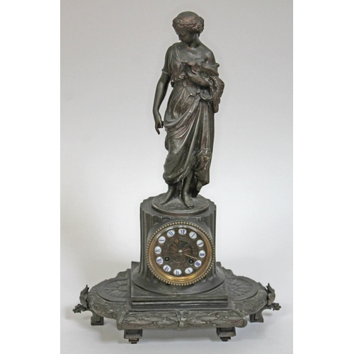 31 - A French spelter mantel clock, height 50cm....