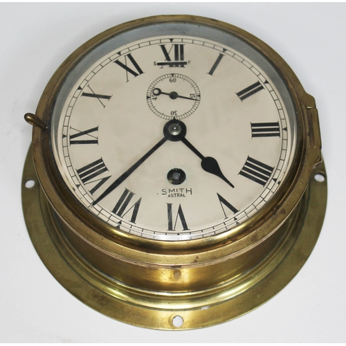 33 - A Smiths Astral brass ship's bulhead clock, total diam. 20.5cm....