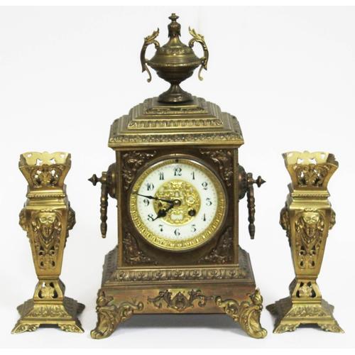 34 - A late 19th century gilt cast brass clock garniture, height 40cm....