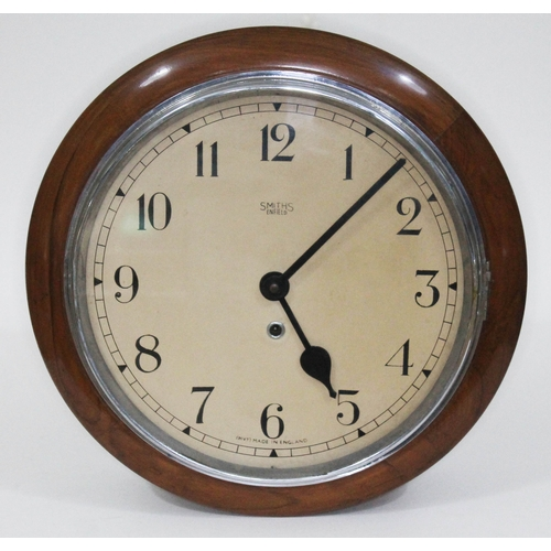 49 - A Smiths Enfield spring driven round wall clock circa 1930, total diam. 38cm.