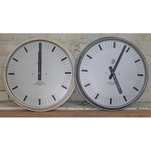 53 - A pair of International Time Recording Co LTD round wall clocks, total diam. 50cm each....