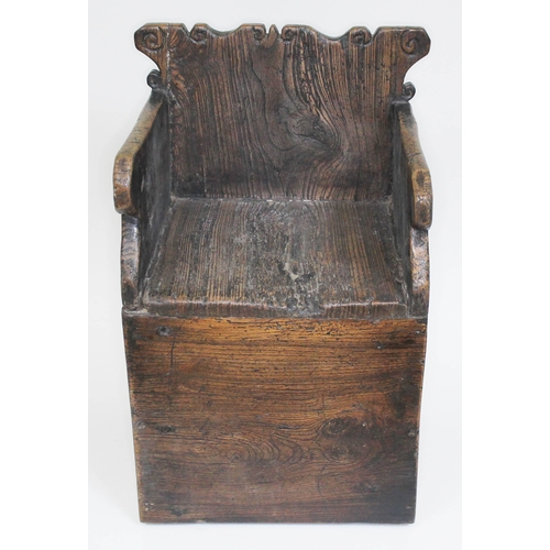 55 - A child's 18th century elm chair of primitive box form with scroll back and arms, width 32cm, depth ...