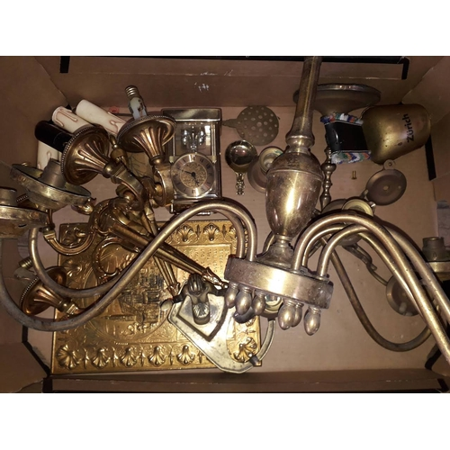21 - A box of brass including light fittings, clock, caddy spoon, bell, candlestick etc....