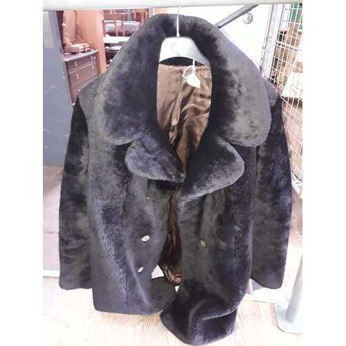 36 - A faux fur jacket....
