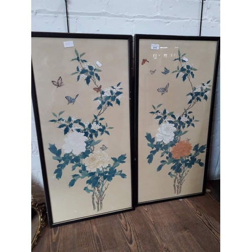 818 - A pair of mid 20th century Japanese paintings on silk depicting flowers and butterflies, 83cm x 40cm...