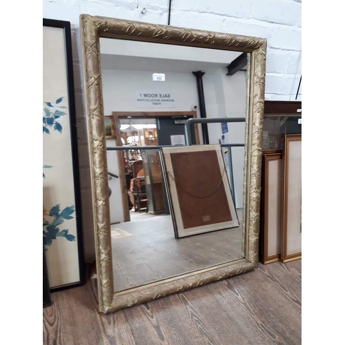 822 - A large early 20th century giltwood framed mirror, 81cm x 55cm....