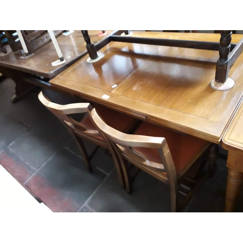 843 - An oak drawer leaf table and four chairs...
