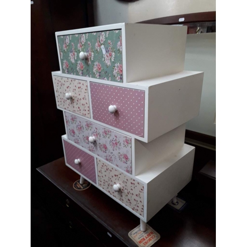 850 - A white painted and decorated set of drawers on tapered legs, H74cm, W53cm, D32cm....