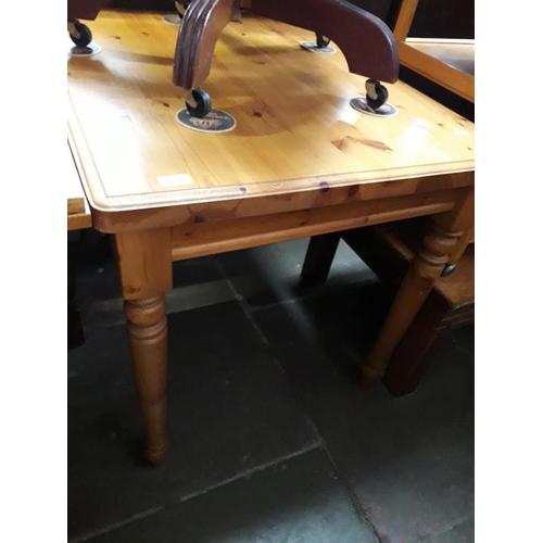 851 - A pine square table, H74cm, W91cm, D74cm....