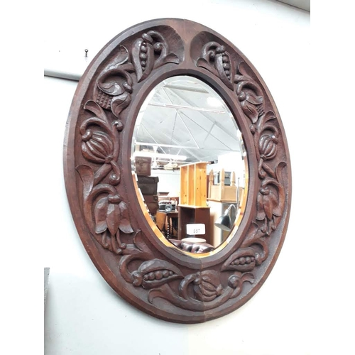 857 - A carved framed oval mirror 53cm x 66cm....