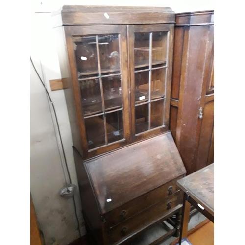 859 - An oak bureau bookcase....