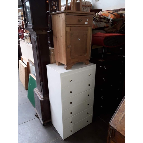 866 - A continental pine bedside cabinet and a white painted chest of drawers....