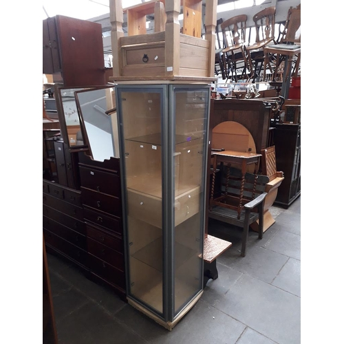 887 - A glazed corner display cabinet and a small rustic table with drawer....