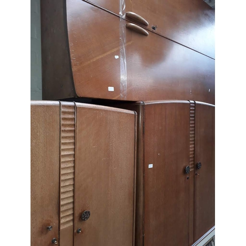 899 - Three oak veneered wardrobes....