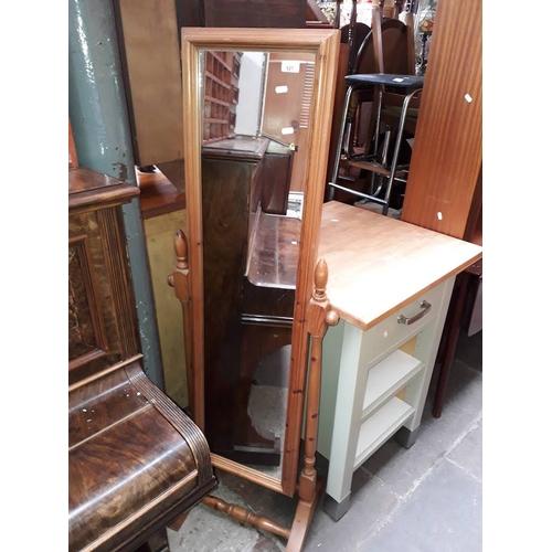 927 - A pine cheval mirror....