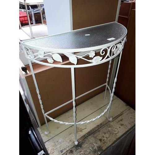 947 - A wrought metal console table....