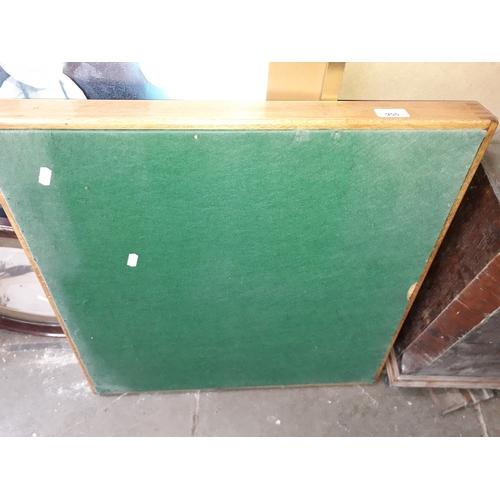 955 - A green baize top folding card table....