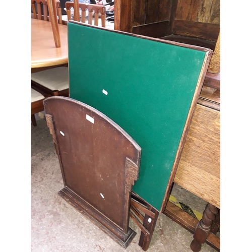 986 - A green baize top folding card table and a wooden fire screen....
