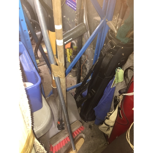 378 - A snow shovel, 2 sweeping brushes and a pick stick...