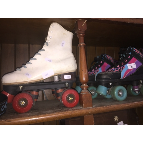 43 - 2 sets of roller boots...