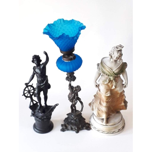 516 - A mixed lot comprising a spelter figure, a figural oil lamp and a plaster figure, tallest 50cm....