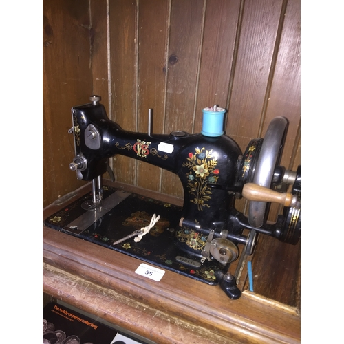 55 - A hand cranked CWS Family sewing machine...