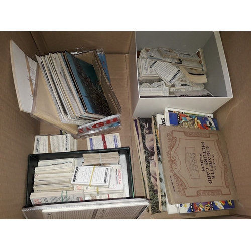 1030 - A box of cigarette collectors cards and postcards...