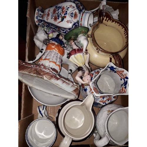 1034 - A pottery box of jugs...