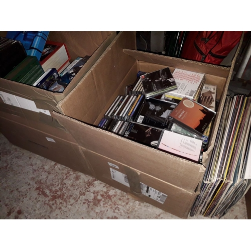 1050 - Two boxes of CDs and DVDs and a few LPs....