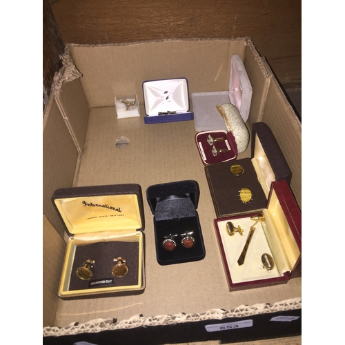 553 - A box containg cufflinks and  tiepins...
