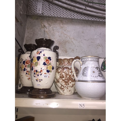 572 - Pair of Edwardian pottery vases and two wash jugs...