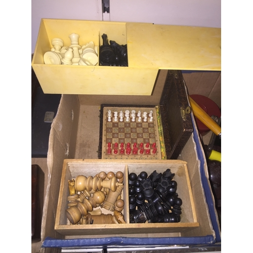 595 - Two wooden chess sets and two travel chess sets...