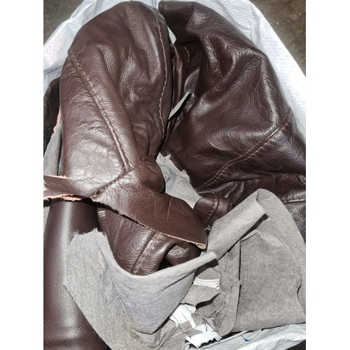 363 - A box of horse riding boots and a bag of leather off cuts...