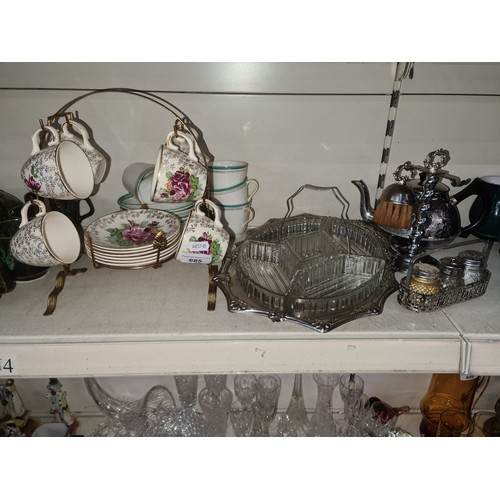 685 - Pottery teaware on stand and some metalware...