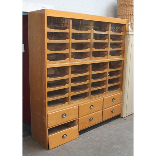 1 - A large Haberdashery cabinet, 32 interior drawers with sliding glass above six lower drawers with cu...