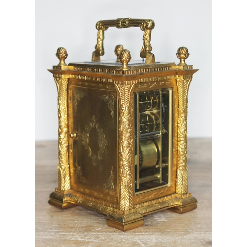 10 - A French late 19th century gilt engraved and chased repeater carriage clock, the dial with Roman num...