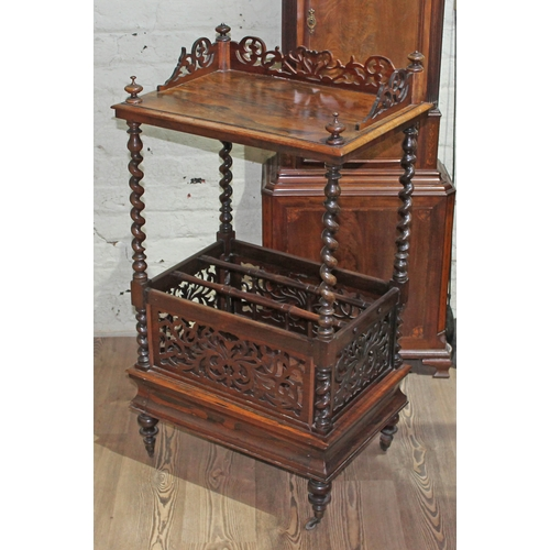 11 - A Victorian rosewood Canterbury whatnot with fretwork gallery, turned finials, twist columns, furthe...