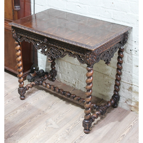 12 - A 19th century carved oak side table with frieze drawer, twist legs and twist H frame stretcher, wid...