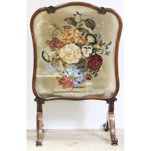 14 - A William IV/early Victorian carved rosewood fire screen, embroidered panel, scroll supports and leg...