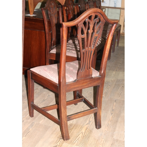 15 - A set of six George III mahogany dining chairs with pierced splat backs, fluted legs and H frame str...