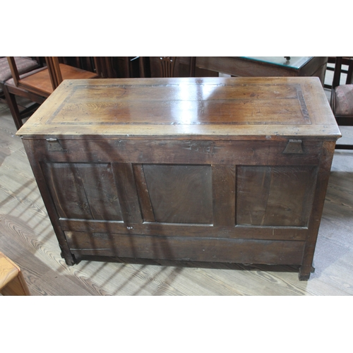 16 - An 18th century panelled and joined oak mule chest, width 121cm, depth 52.5cm & height 79cm....