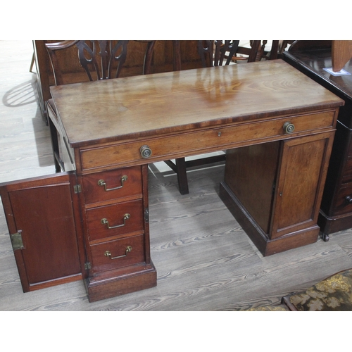 17 - A George III Regency period mahogany knee hole desk with single frieze drawer having brass knobs and...
