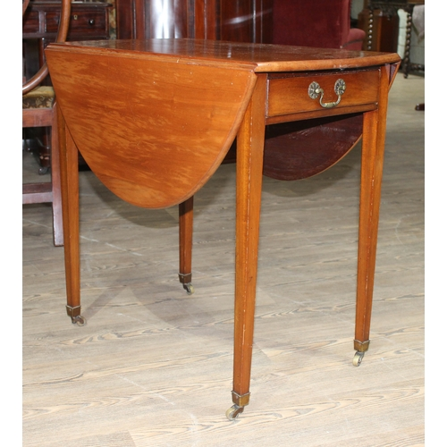 18 - A Edwardian mahogany Pembroke table, oval top single drawer, tapered legs and brass castors....