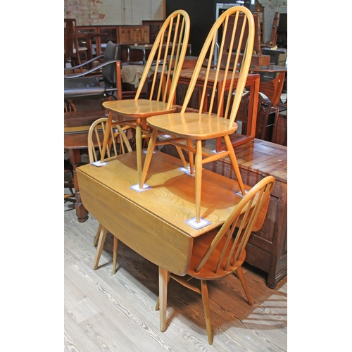 2 - An Ercol light elm and beech drop leaf table and four chairs....