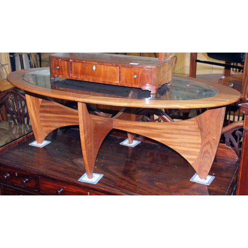 20 - A G-Plan Astro teak and glass top coffee table of oval form....