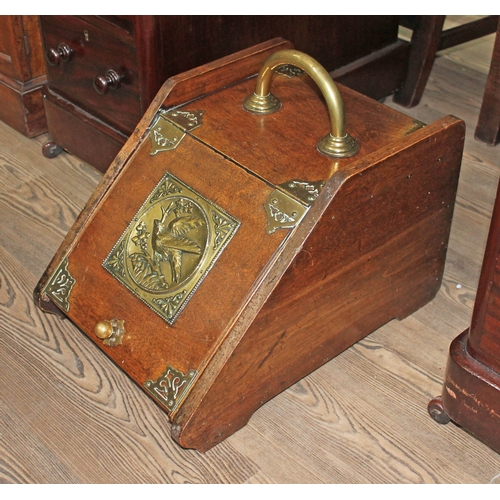22 - A Victorian oak coal scuttle with Aesthetic panel and brass mounts and handle....