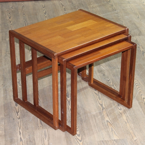 25 - A Danish style teak nest of tables....