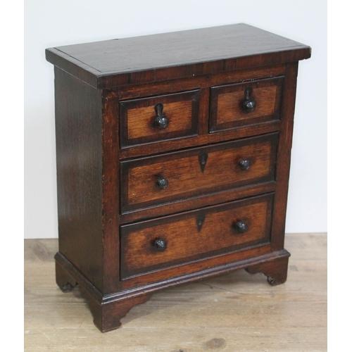 26 - A 19th century cross banded oak apprentice chest, width 31cm, depth 15.5cm & height 35cm....
