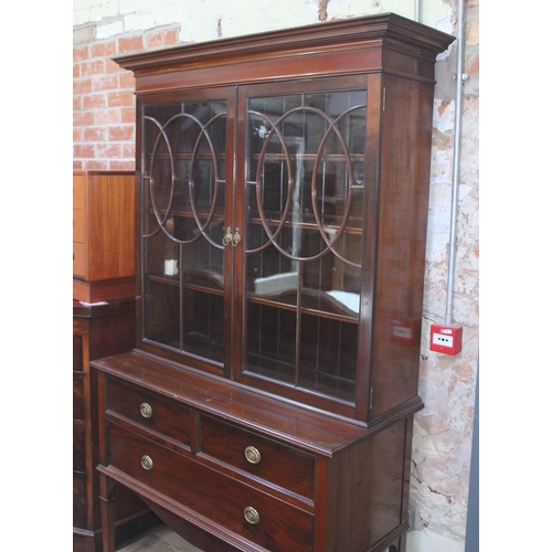 31 - A good quality Edwardian bookcase with flared cornice, astral glazed cabinet top with adjustable int...